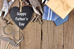 Happy Fathers Day chalkboard heart with top corner border on wood Royalty Free Stock Photography