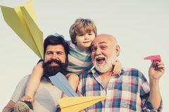 Happy fathers day. Child happy. Male multi generation family. Family people. Child pilot aviator with paper airplane stock photos