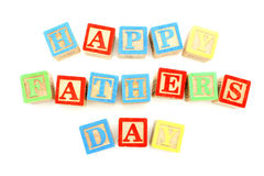 Happy Fathers Day. Child's toy block letters spelling Happy Fathers Day over white Royalty Free Stock Image