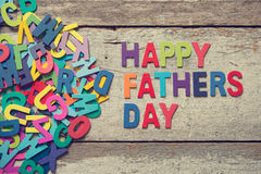 HAPPY FATHERS DAY. The colorful words HAPPY FATHERS DAY on old wooden plank stock images