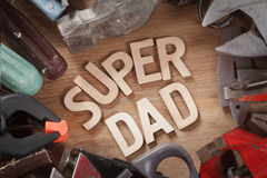 Happy Fathers Day concept with tools on wood background. Happy Fathers Day concept with tools on a rustic wood background Royalty Free Stock Image