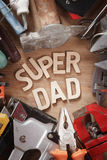 Happy Fathers Day concept with tools on wood background. Happy Fathers Day concept with tools on a rustic wood background Stock Photo