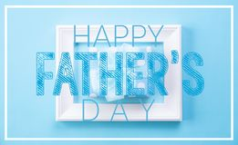 Happy fathers day concept. Top view of picture frame and gift box with happy father`s day text on blue pastel background. Flat la stock photography
