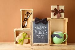 Free Happy Fathers Day Concept With Green Coffee Cup, Chalkboard And Gift Box On Wooden Table Stock Images - 220543724