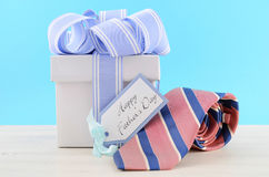 Happy Fathers Day Gift with Blue and White Ribbon Royalty Free Stock Photography