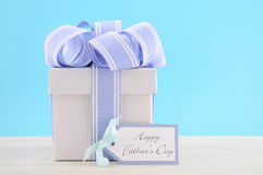 Happy Fathers Day Gift with Blue and White Ribbon Royalty Free Stock Photo