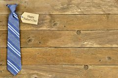 Happy Fathers Day gift tag with blue tie on wood Royalty Free Stock Photos