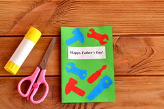 Happy fathers day. Greeting card with paper tools. Scissors, glue. Kids paper craft idea. Father's day gift idea Royalty Free Stock Images
