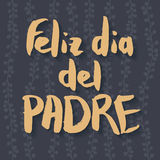 Happy Fathers Day Greeting Card. Spanish phrase Feliz Dia Del Padre. Yellow ink modern calligraphy on decorative dark grey floral background. Trendy hand drawn Royalty Free Stock Photography
