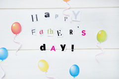 Happy Fathers Day. Letters and Balloons Cut out from Magazine royalty free stock images