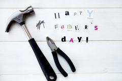 Happy Fathers Day Letters Cut out from Magazine and Tools stock photo