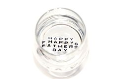 Happy Fathers Day letters reflecting in water. The letters reflecting the Happy Fathers Day in clear water in trasparent wine glass stock photos