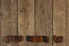 Happy Fathers Day letters on rustic wood. Happy Fathers Day vintage wood letters on a rustic wooden background royalty free stock photography