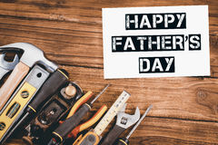 Happy fathers day message next to tools Royalty Free Stock Image
