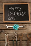 Happy fathers day message with old and new worktools. On wooden plank royalty free stock photos