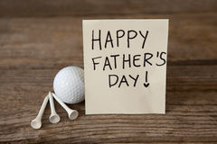Happy fathers day message with sports equipments. On wooden plank royalty free stock image