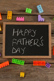 Happy fathers day message written on slate Stock Photos