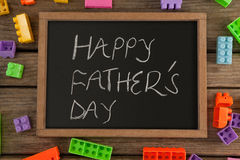 Happy fathers day message written on slate Royalty Free Stock Photography