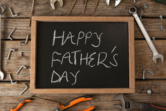 Happy fathers day message written on slate. Close-up of happy fathers day message written on slate royalty free stock image