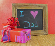 Happy fathers day. With present and blackboard with text i love dad royalty free stock images