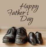 Happy fathers day, fathers shoes and baby boys shoes overhead, flat lay.  stock images