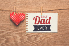 Happy fathers day sign with heart on wooden background. royalty free stock image