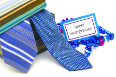 Happy Fathers Day. Tag with gift box and ties over white royalty free stock photos