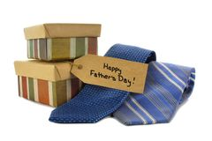 Happy Fathers Day. Tag with gift boxes and ties over white stock photo