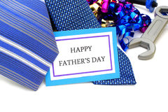 Happy Fathers Day. Tag with neckties, tools and ribbon stock images