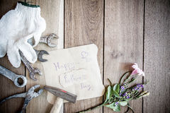 Happy Fathers Day with top border of tools and ties on a rustic Royalty Free Stock Photo