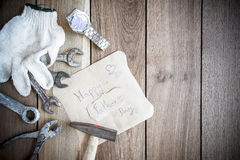 Happy Fathers Day with top border of tools and ties on a rustic Stock Photos