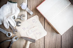 Happy Fathers Day with top border of tools and ties on a rustic Stock Photo