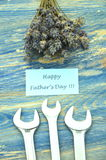 Happy fathers day wishes, bunch of gorgeous lavender flowers and spanners Royalty Free Stock Photo