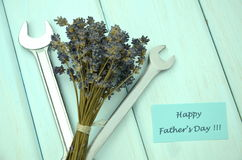 Happy fathers day wishes, bunch of gorgeous lavender flowers and spanners Royalty Free Stock Photos