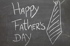 Happy Fathers Day written on the blackboard.  Royalty Free Stock Photo