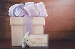 Happy Fathers Gift with blue and white gift on wood background. Stock Images