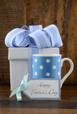 Happy Fathers Gift with blue and white gift on wood background. Stock Photo