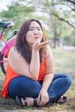 Happy fatty woman posing with bicycle Royalty Free Stock Images