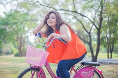 Happy fatty woman posing with bicycle Stock Images