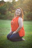 Happy fatty woman posing outdoor Royalty Free Stock Photography