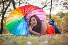 Happy fatty woman with umbrella Royalty Free Stock Photo