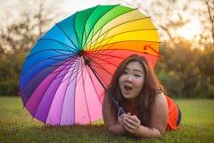 Happy fatty woman with umbrella Royalty Free Stock Image