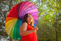 Happy fatty woman with umbrella Stock Images