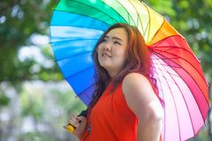 Happy fatty woman with umbrella Stock Image