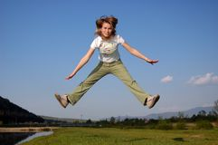 Happy feel. Photo of a woman...jump in air royalty free stock image