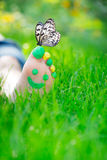 Happy feet. Child lying on green grass. Kid having fun outdoors in spring park Royalty Free Stock Images
