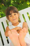 Happy feet (girl portrait). Portrait of a cute little smiling girl Stock Images