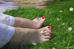 Happy feet near water Stock Photos