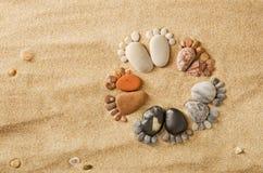 Happy feet. Stone arranged like footprints on the beach Stock Photography