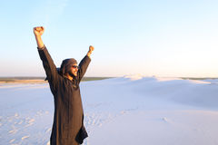 Happy fellow Arabian, walks through desert, smiles and enjoys li Stock Image